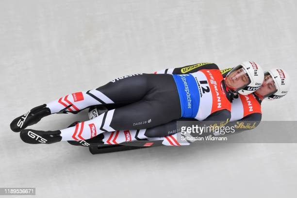 Yannick Mueller and Armin Frauscher of Austria compete in the Doubles event during the FIL Luge World Cup at Olympia-Rodelbahn on November 23, 2019...