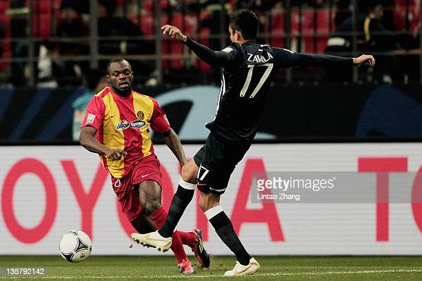 Yannick Ndjeng of Esperance Sportive and Jesus Zavala of Monterrey challenge for the ball during the FIFA Club World Cup 5th Place match between Club...