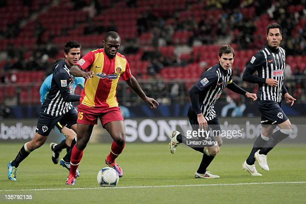 Yannick Ndjeng of Esperance Sportive de Tunis challenge for the ball during the FIFA Club World Cup 5th Place match between Club de Futbol Monterrey...