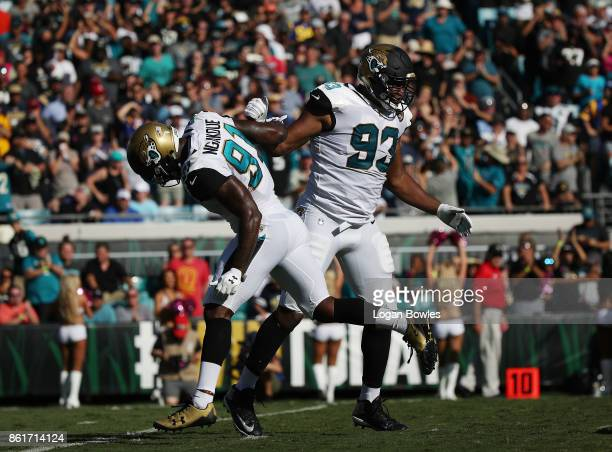Yannick Ngakoue and Calais Campbell of the Jacksonville Jaguars celebrate after Campbell sacked Jared Goff of the Los Angeles Rams in the first half...
