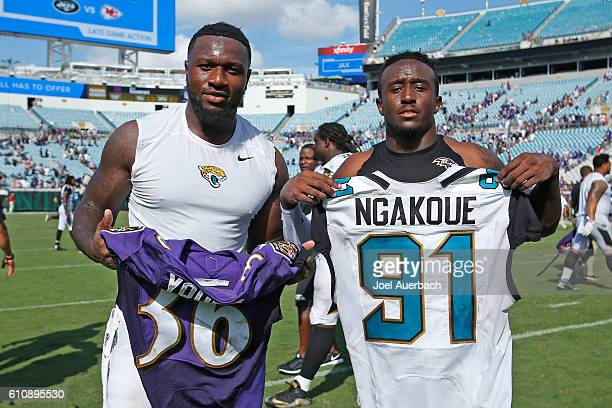 Yannick Ngakoue of the Jacksonville Jaguars and Tavon Young of the Baltimore Ravens pose after exchanging jerseys after an NFL game on September 25...