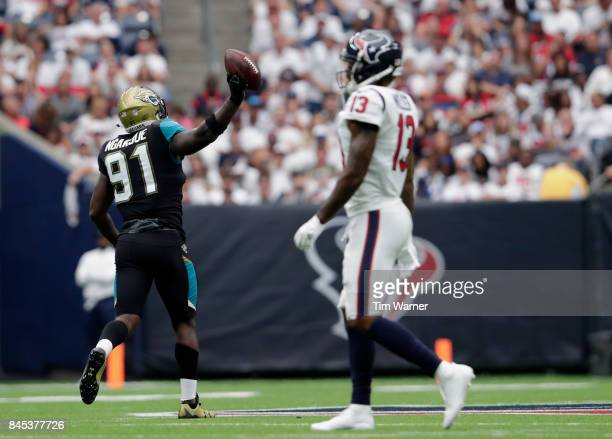 Yannick Ngakoue of the Jacksonville Jaguars celebrates a fumble recovery in the fouth quarter as Braxton Miller of the Houston Texans walks to the...