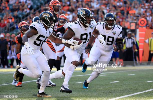 Yannick Ngakoue of the Jacksonville Jaguars returns an interception for a touchdown against the Cincinnati Bengals at Paul Brown Stadium on October...