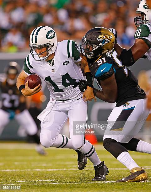 Yannick Ngakoue of the Jacksonville Jaguars sacks Quarterback Ryan Fitzpatrick of the New York Jets during the first quarter of an NFL preseason game...