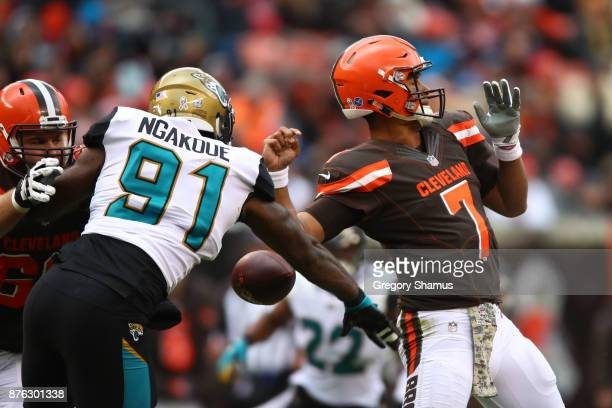 Yannick Ngakoue of the Jacksonville Jaguars strips the ball from DeShone Kizer of the Cleveland Browns in the first half at FirstEnergy Stadium on...