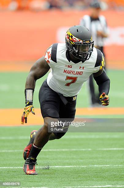 Yannick Ngakoue of the Maryland Terrapins defends against the Syracuse Orange at the Carrier Dome on September 20 2014 in Syracuse New York