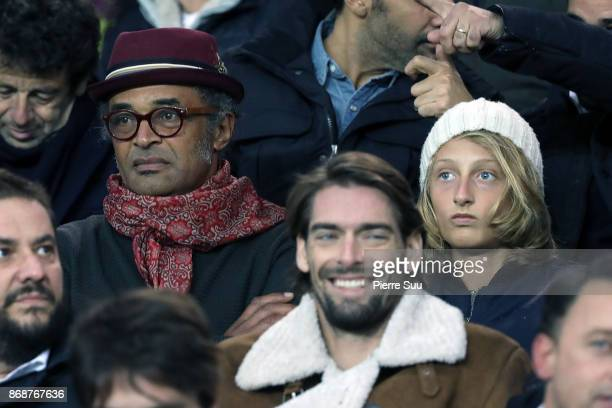 Yannick Noah and his son Joalukas are seen in the stands during the UEFA Champions League group B match between Paris SaintGermain and RSC Anderlecht...