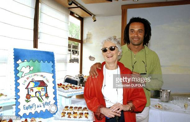 Yannick Noah and mother Marie Claire Noah at press conference for 5th Tennis Concert, on April 23, 1998 in France.