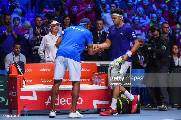 Yannick Noah coach of France shakes hand with Jo Wilfried Tsonga of France during the day 1 of the Final of the Davis Cup match between France and...