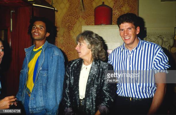 Yannick Noah, his mother Marie-Claire Perrier and a guest attend a party at Le Palace on 1986 in Paris, France.