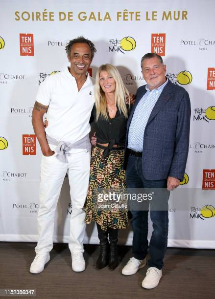 Yannick Noah his wife Isabelle Camus and her father JeanClaude Camus attend the gala for 'Fete le mur' an association founded by Yannick Noah to...