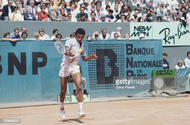 Yannick Noah of France makes a forehand return against Mats Wilander of Sweden during their Men's Singles Quarterfinal match at the French Open...