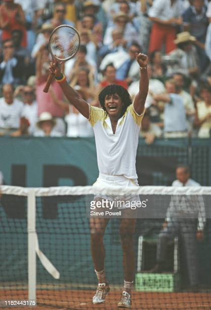 Yannick Noah of France raises his arms in celebration after defeating Mats Wilander in the Men's Singles final match during the French Open Tennis...