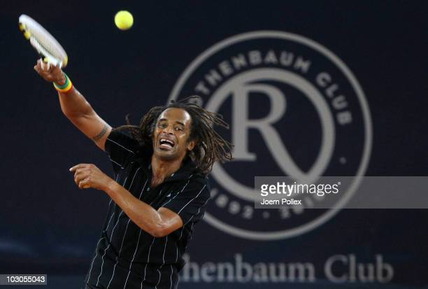 Yannick Noah of France returns a forehand during his friendly match against Michael Stich of Germany during the International German Open at...