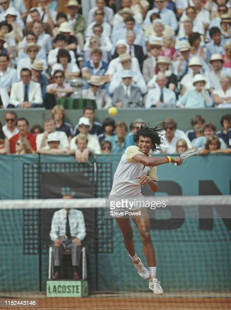 Yannick Noah of France rpowers a fore hand return against Mats Wilander during their Men's Singles final match of the French Open Tennis Championship...