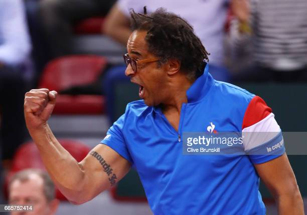 Yannick Noah the France captain reacts during the singles match between Lucas Pouille of France and Kyle Edmund of Great Britain on day one of the...