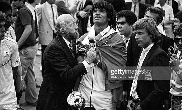 Yannick Noah winning the French Open tennis tournament , Roland-Garros, Paris, France, 1983.