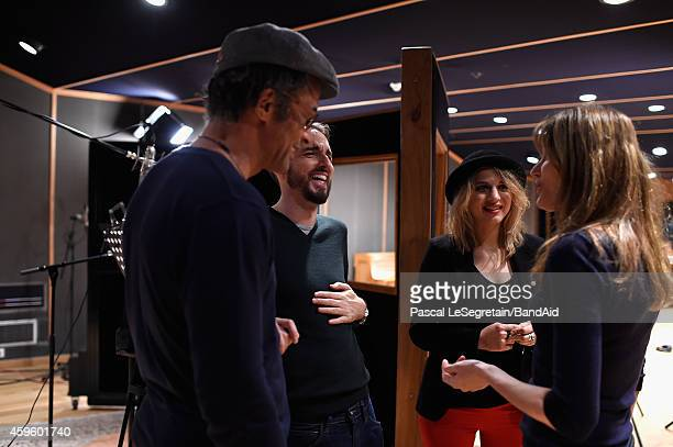 Yannick NoahChristophe Willem Amandine Bourgeois and Carla Bruni attend the Band Aid 30 'Noel est la' Recording on November 23 2014 in Paris France