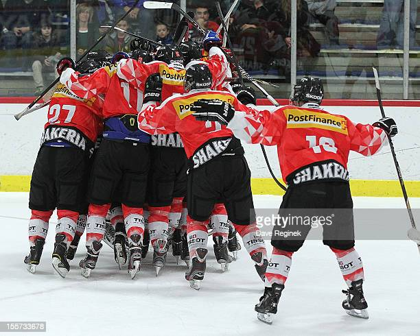 Yannick Rathgeb of team Switzerland celebrates his game winning shoot-out goal with teammates against team USA during game two of the U-18 Four...