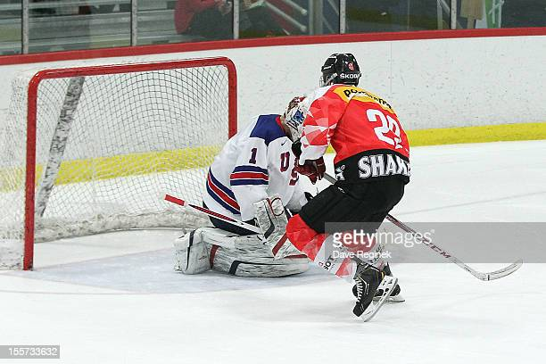 Yannick Rathgeb of team Switzerland scores the game winning shoot-out goal on Hunter Miska from team USA during game two of the U-18 Four Nations Cup...