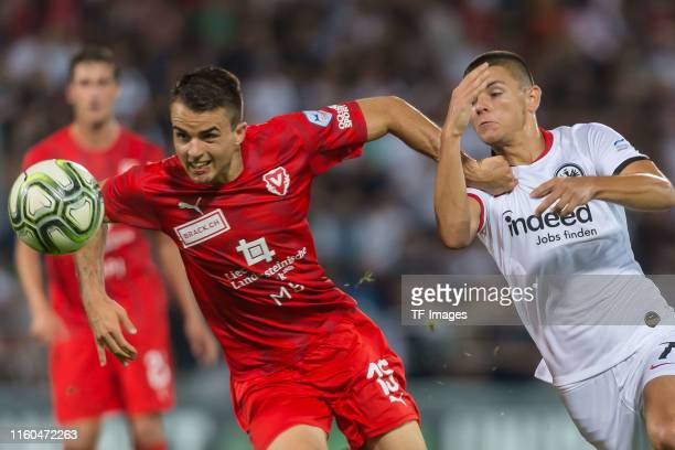 Yannick Schmid of FC Vaduz and Dejan Joveljic of Eintracht Frankfurt battle for the ball during the UEFA Europa League Third Qualifying Round match...