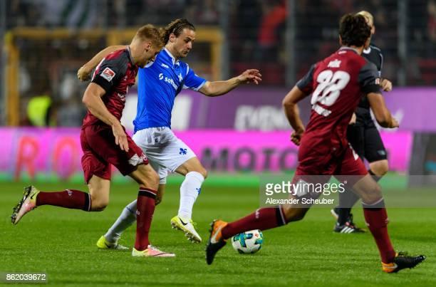 Yannick Stark of Darmstadt in action against Hanno Behrens of Nuernberg during the Second Bundesliga match between SV Darmstadt 98 and 1 FC Nuernberg...