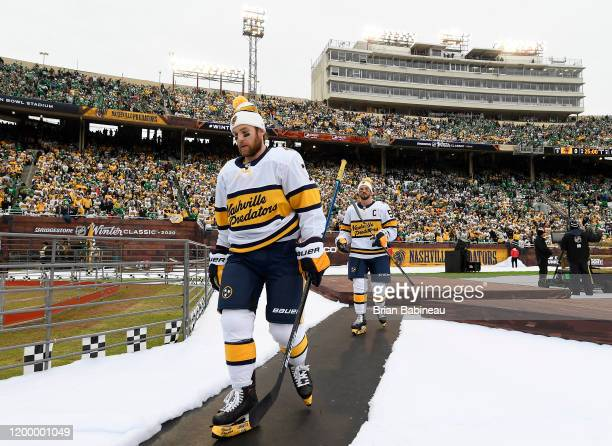 Yannick Weber and Roman Josi of the Nashville Predators walk back to the locker room after warmup prior to the 2020 NHL Winter Classic between the...