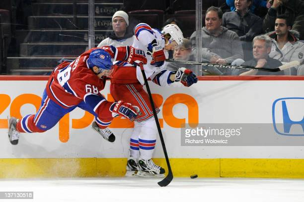 Yannick Weber of the Montreal Canadiens body checks Carl Hagelin of the New York Rangers during the NHL game at the Bell Centre on January 15 2012 in...