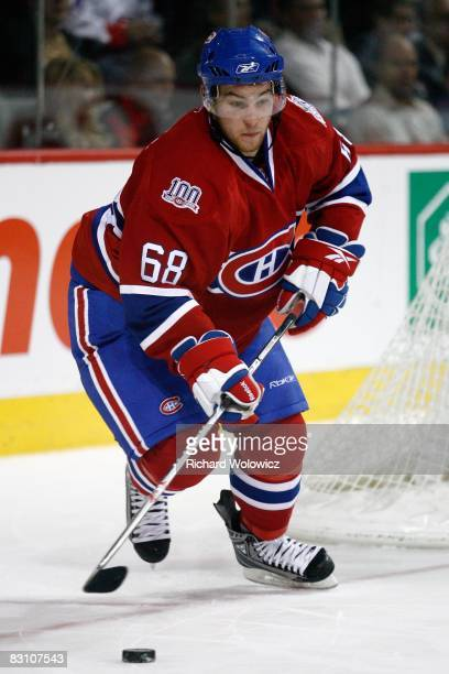 Yannick Weber of the Montreal Canadiens skates with the puck during the game against the Detroit Red Wings at the Bell Centre on September 30 2008 in...