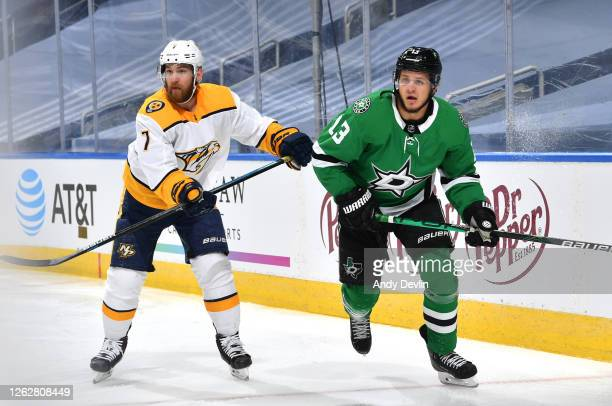 Yannick Weber of the Nashville Predators and Mattias Janmark of the Dallas Stars watch the play during the second period of the exhibition game prior...