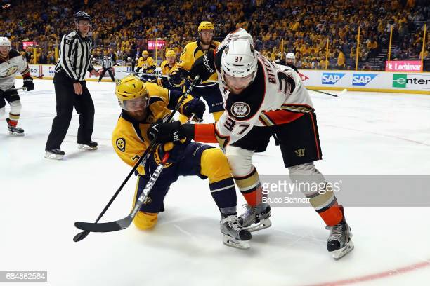 Yannick Weber of the Nashville Predators and Nick Ritchie of the Anaheim Ducks battle for position during the second period in Game Four of the...