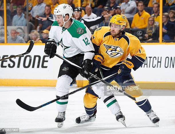 Yannick Weber of the Nashville Predators battles against Radek Faksa of the Dallas Stars during an NHL game at Bridgestone Arena on October 18 2016...