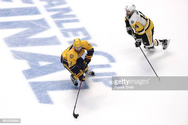 Yannick Weber of the Nashville Predators is defended by Chris Kunitz of the Pittsburgh Penguins in Game Six of the 2017 NHL Stanley Cup Final during...