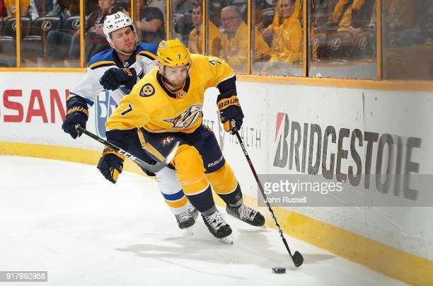 Yannick Weber of the Nashville Predators protects the puck against Vladimir Sobotka of the St Louis Blues during an NHL game at Bridgestone Arena on...