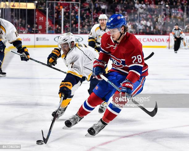 Yannick Weber of the Nashville Predators reaches for the puck against Nathan Beaulieu of the Montreal Canadiens during the NHL game at the Bell...