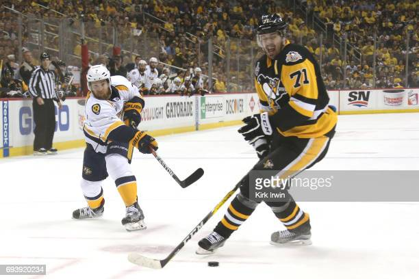 Yannick Weber of the Nashville Predators shoots in the first period against Evgeni Malkin of the Pittsburgh Penguins in Game Five of the 2017 NHL...