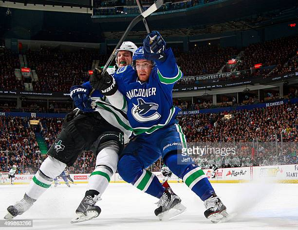 Yannick Weber of the Vancouver Canucks and Jamie Benn of the Dallas Stars battle for position during their NHL game at Rogers Arena December 3 2015...