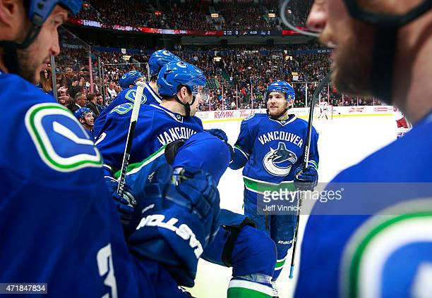 Yannick Weber of the Vancouver Canucks is congratulated by teammates after scoring during their NHL game against the Arizona Coyotes at Rogers Arena...