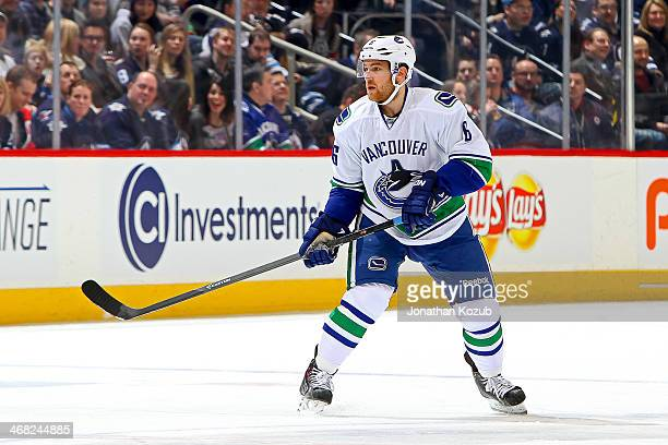 Yannick Weber of the Vancouver Canucks keeps an eye on the play during first period action against the Winnipeg Jets at the MTS Centre on January 31...