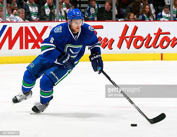Yannick Weber of the Vancouver Canucks skates up ice with the puck during their NHL game against theTampa Bay Lightning at Rogers Arena October 18...