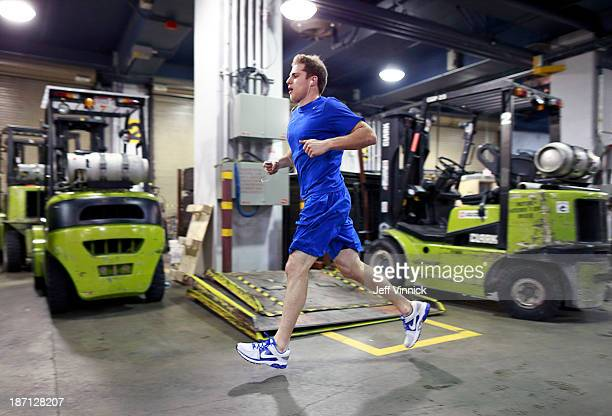 Yannick Weber of the Vancouver Canucks warms up before their NHL game against the Detroit Red Wings at Rogers Arena on October 30 2013 in Vancouver...