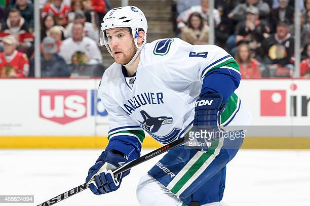 Yannick Weber of the Vancouver Canucks watches for the puck during the NHL game against the Chicago Blackhawks at the United Center on April 2 2015...