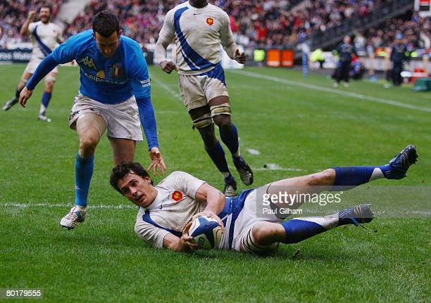 Yannick Yauzion of France gathers a kick ahead to score his team's second try during the RBS Six Nations Championship match between France and Italy...