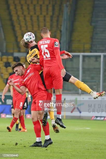 Yannik Moeker of FSV Zwickau and Christoph Daferner of SG Dynamo Dresden and Steffen Nkansah of FSV Zwickau battle for the ball during the 3 Liga...