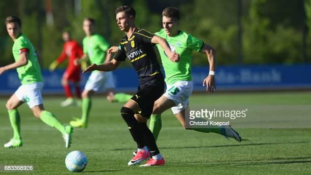 Yannik Moeker of Wolfsburg challenges Alexander Laukart of Dortmund during the U19 German Championship Semi Final second leg match between Borussia...