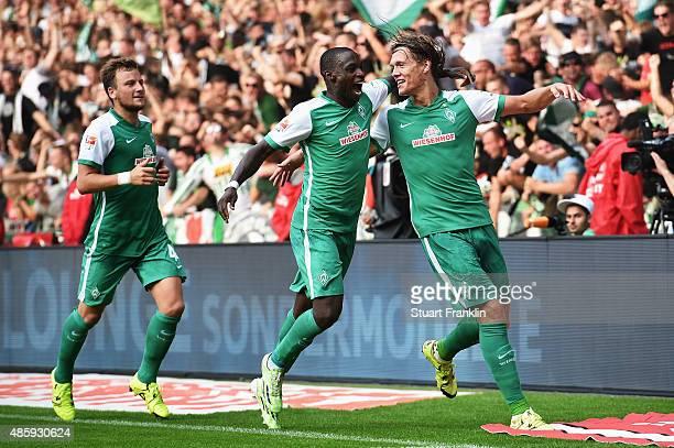 Yannik Vestergaard of Bremen celebrates scoring his goal with Anthony Ujah during the Bundesliga match between Werder Bremen and Borussia...