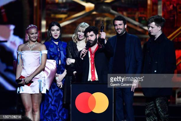Yannis Philippakis, Jack Bevan, Jimmy Smith and Edwin Congreave of the band Foals accept the Best Group award during The BRIT Awards 2020 at The O2...