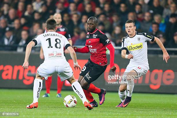 Yannis Salibur of Guingamp and Baptiste Santamaria and Pierrick Capelle of Angers during the Ligue 1 match between Guingamp and Angers at Stade du...