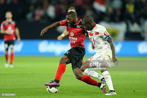 Yannis Salibur of Guingamp and Rio Mavuba of Lille during the Ligue 1 match between EA Guingamp and Lille OCS at Stade du Roudourou on October 15,...