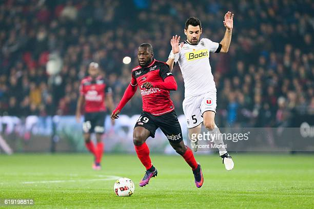 Yannis Salibur of Guingamp and Thomas Mangani of Angers during the Ligue 1 match between Guingamp and Angers at Stade du Roudourou on October 29 2016...